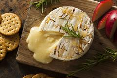 Homemade baked brie with honey Stock Photos