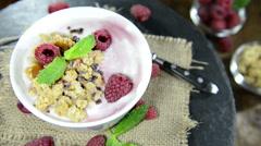 homemade raspberry yogurt (loopable) - stock footage