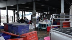 Panning shot of a small fish market after the morning auction Stock Footage