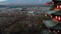 View of Mount Fuji from Chureito Pagoda, tilt up Stock Footage