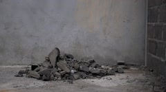 Worker Throws Demolition Waste on the Work Site. Stock Footage