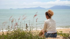 Female Relaxing at Beach Enjoying Sun. Stock Footage