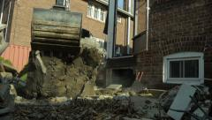 Slider shot of Excavator lifting large peice of rubble Stock Footage