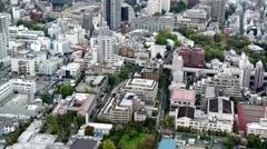 High angle view over city buildings and streets in Central Tokyo - stock footage