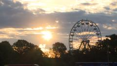 BEAUTIFUL SUNRISE TIME-LAPSE OF FERRIS WHEEL AND CLOUDS AMUSMENT PARK  Stock Footage