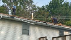 Roofers Stripping Off Old Shingles Stock Footage