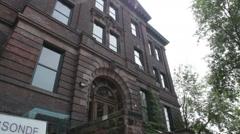 Slow camera tilt of Lassonde Mining Building at the University of Toronto campus Stock Footage