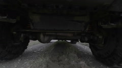 Undercarriage of a truck while driving off road Stock Footage