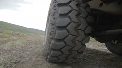 Knobby tire POV while driving off road Stock Footage