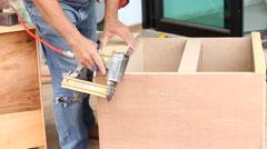 Carpenter used air-gun for make new furniture Stock Footage