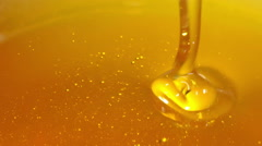 Pouring honey. - stock footage