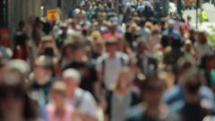 Crowd of people walking on city street sidewalk 4k slow motion Stock Footage