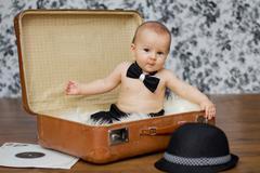 Baby boy in a suitcase Stock Photos