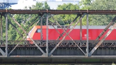 4K UHD Freight Train transporting Cargo Container on old metal bridge Stock Footage
