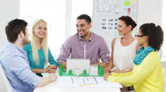 smiling architects doing high five in office - stock footage