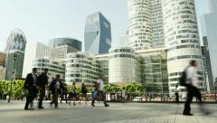 people moving. business professionals. modern glass buildings skyscrapers. - stock footage