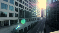 modern office building. sun beaming. sunbeam. sun flare. urban city district - stock footage