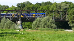 Train regional passengers train over Isar rive in Munich Stock Footage