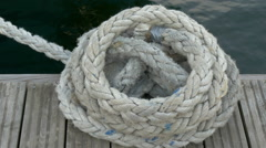 A big rope tied on the edge of the port in estonia Stock Footage
