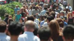 Crowd of people walking on city street sidewalk slow motion Stock Footage