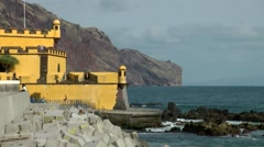 Portugal Madeira 068 yellow fortress of Funchal with groins and the steep coast Stock Footage