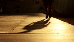 silhouette of male person walking. slow motion. sunset light - stock footage