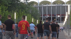 Real football soccer supporters fans going to stadium, big match in town, crowd Stock Footage