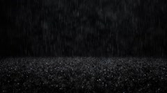 Rain on black background - stock footage