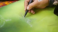 Siem reap, cambodia - circa dec 2013: the artist works on a painting. close-u Stock Footage