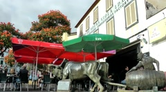 Portugal Madeira 079 street café with red sunshades in Funchal old town Stock Footage