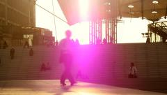 silhouette of person walking. city urban scenery. colorful sunset view - stock footage