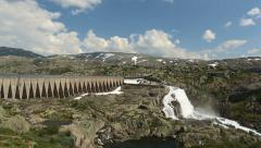 Dam barrier for producing hydroelectric electricy. Road crossing the dam - stock footage