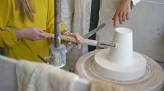 Female potter shaping pot in workshop Stock Footage