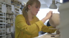 Female artist carving crafts product in workshop Stock Footage