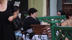Hungry overweight woman eating out, restaurant, morbidly fat person Stock Footage