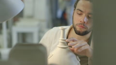 Male artist carving crafts product in workshop Stock Footage