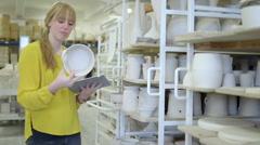 Female potter using digital tablet in workshop Stock Footage