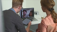 Business colleagues video chatting Stock Footage