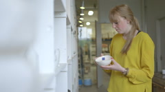 Female potter checking pottery in workshop Stock Footage