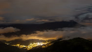 Time lapse over Banos by night with Tungurahua volcano in the background Stock Footage