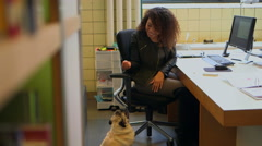 Businesswoman petting dog Stock Footage