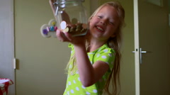 Girl holding a jar with coins - stock footage