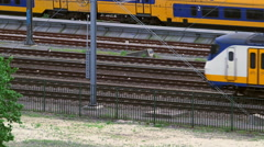 Train moving slowly on railway track Stock Footage