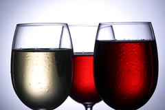 Wine glasses in backlight Stock Photos