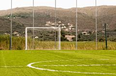 Goal at a small local football field with mountain background Stock Photos
