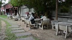 Men playing chess in park in Thailand Stock Footage