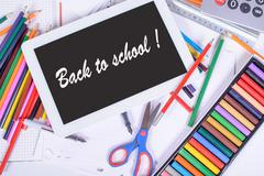 back to school written on a digital tablet - stock photo