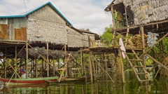 Siem reap, cambodia - 21 dec 2013: village on high wooden stilts on tonle sap Stock Footage
