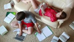 Students with books and laptop are learning at home - stock footage