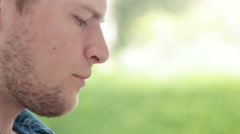 Man sitting outdoor reading, takes a sip of coffee Stock Footage